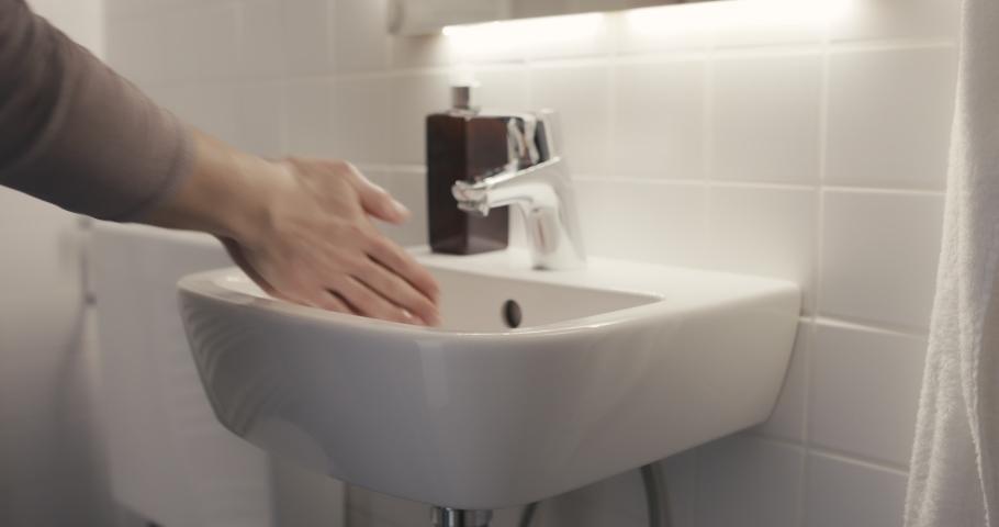 Woman washing hands the best way coronavirus rinse water rub soap dry towel covid | Shutterstock HD Video #1047758791