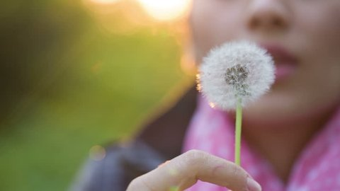 Woman Blowing on a Dandelion 4