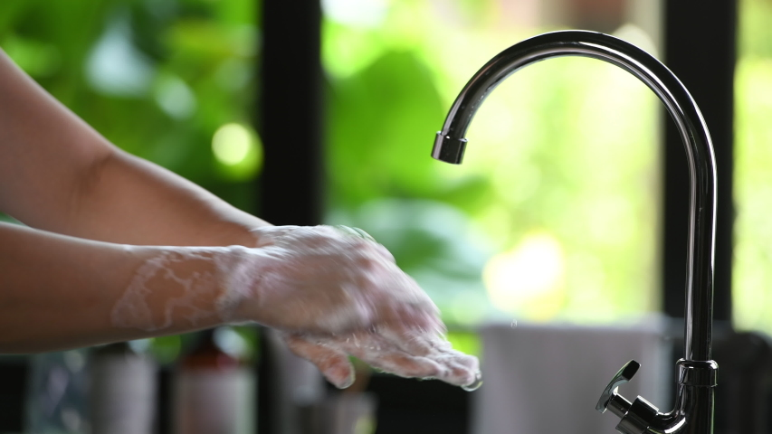 Hand washing to prevent coronavirus ( Covid-19 ) infection . | Shutterstock HD Video #1048352641
