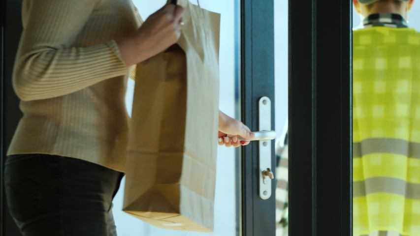 The courier delivers food home. Delivery of food in quarantine | Shutterstock HD Video #1048807021
