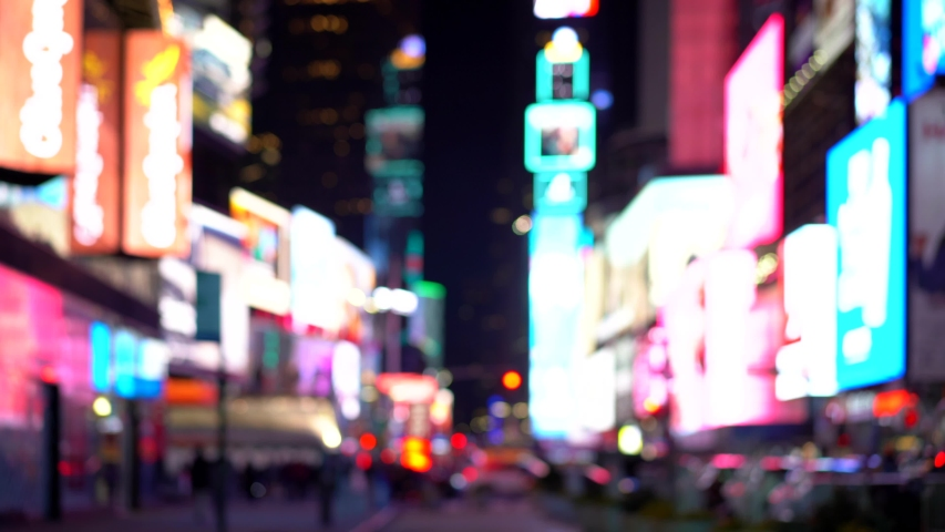 OUT OF FOCUS: Traffic in Times Square. T. S. is a busy tourist intersection of commerce Advertisements and a famous street of New York City and US.  | Shutterstock HD Video #1049306071