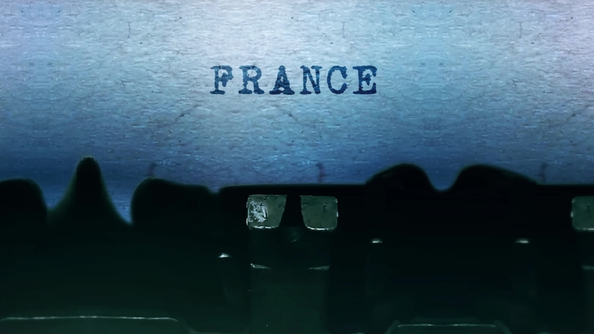 France Word closeup Being Typing and Centered on a Sheet of paper on old vintage Typewriter mechanical 4k Footage Background Animation. | Shutterstock HD Video #1049401351