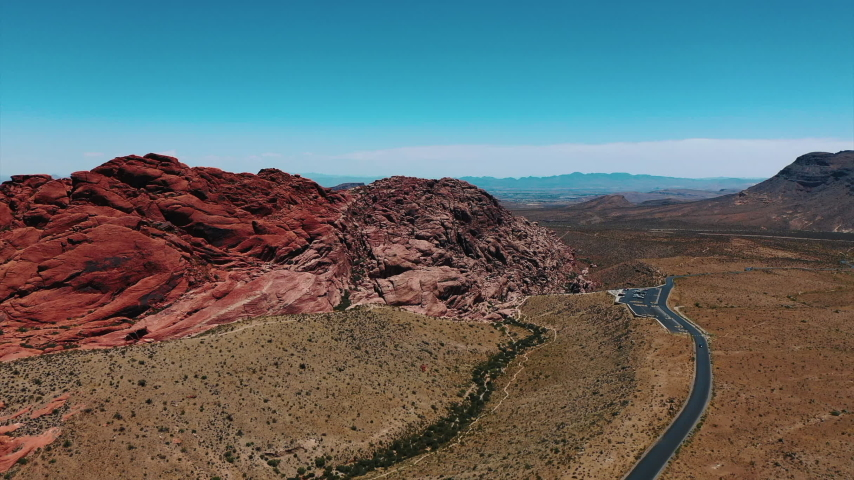 Stunning aerial landscape views of Red Rock Canyon in in Nevada's Mojave Desert near Las Vegas. | Shutterstock HD Video #1049465521