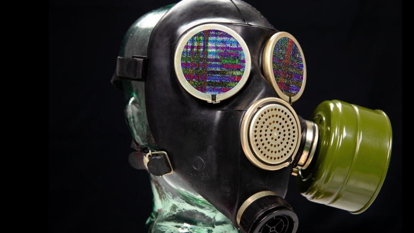 A gas mask for protection from viruses against black background with static in the eye piecec | Shutterstock HD Video #1049955751
