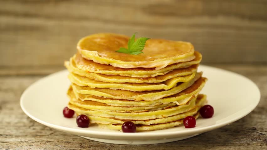 Delicious chocolate pancakes with berries how to make it stock honey is poured on a stack of pancakes on wooden background breakfast hd stock ccuart Choice Image