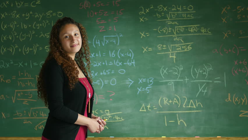 Math teacher in front of chalkboard, wide shot | Shutterstock HD Video #10527701