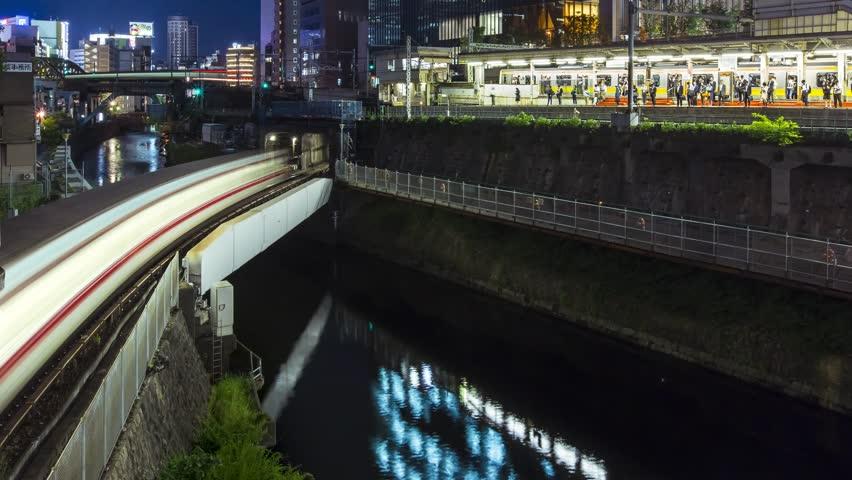 Time-lapse of multiple train lines in Ochanomizu, Tokyo, Japan, at night. | Shutterstock HD Video #10536671