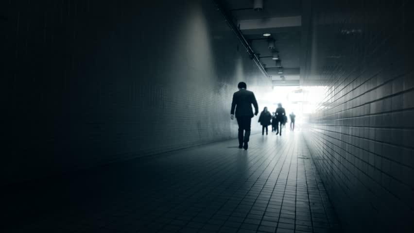 Stock Video Clip of A man walking in a dark room | Shutterstock