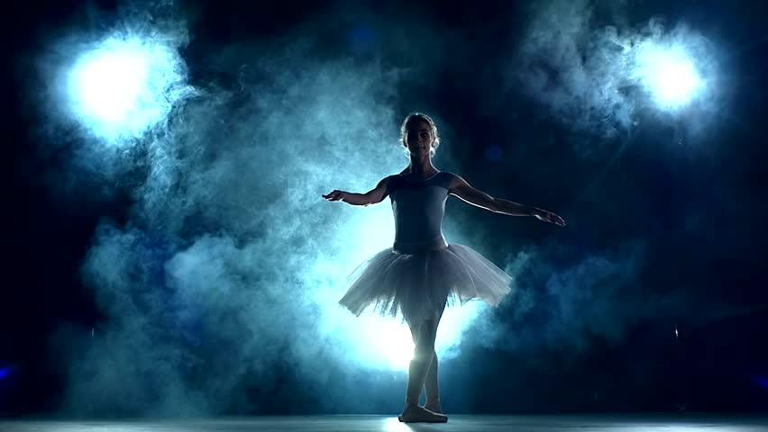 graceful ballerina doing a workout in the classroom. Smoke, fog, silhouette. ballet dancer in white tutu, girl in pointe, whirls around you, slow motion #10617791