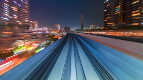 Point of view time-lapse through Tokyo tunnels via the automated guideway transit system (AGT) called the Yurikamome at night.