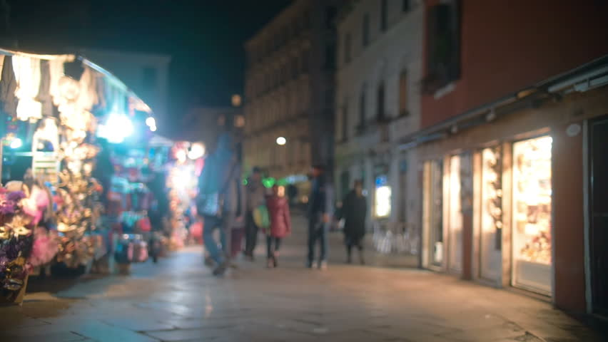 Slow motion steadicam shot of Venetian street in the evening. People walking among shops and counters | Shutterstock HD Video #10638341