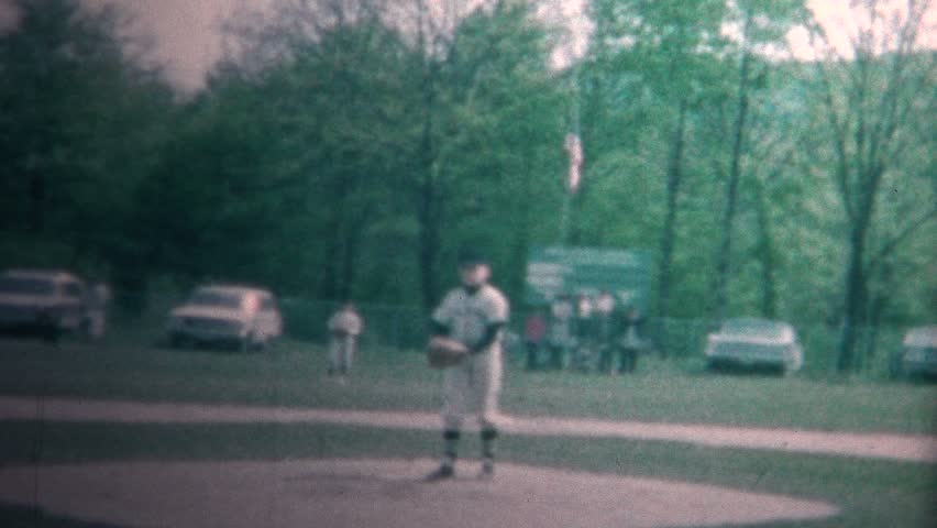 COLUMBUS, OHIO - SEPTEMBER 1965: Boy playing little league baseball is pitching in this popular American pastime.