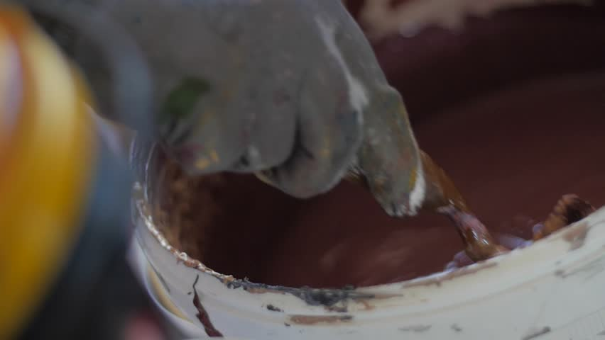 Slow motion of a painter hand mixing color