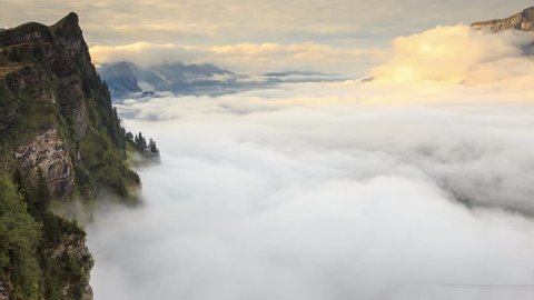 Time-lapse of the mist and cloud moving over Engelberg Valley near Titlis. Viewed from Trubsee, Switzerland.