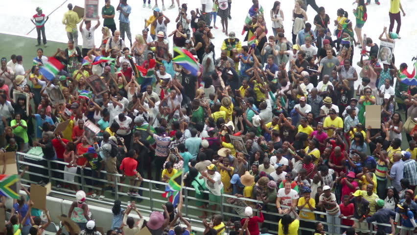 """CAPE TOWN SOUTH AFRICA 11 DECEMBER 2014  Dancing and flag waving at """"Nelson Mandela a life celebrated""""  Cape Town Stadium 11 Dec 2013"""