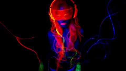 4k fantastic video of sexy cyber raver dancer babe filmed in fluorescent clothing under UV black light