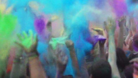 Wels, austria - June 13 2015- Celebration of Holi colors festival. Crowd waving hands at concert, open air festival, slow motion