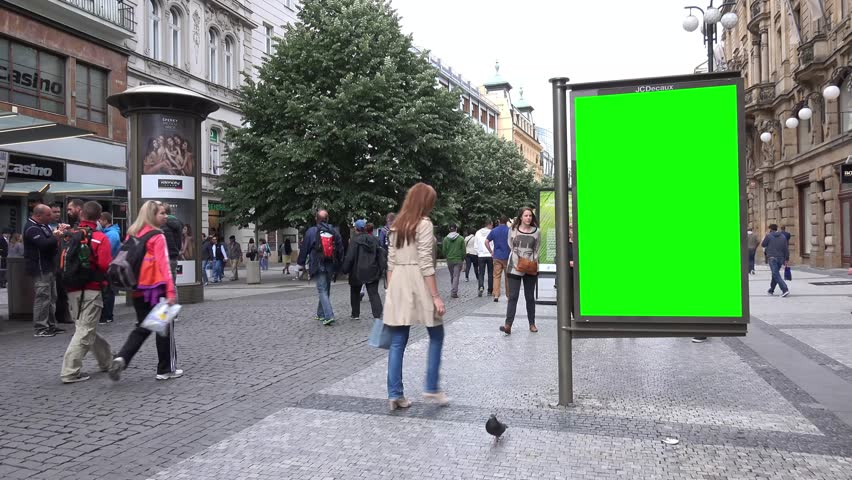 PRAGUE, CZECH REPUBLIC - MAY 30, 2015: billboard in the city - urban street - pavement with walking people