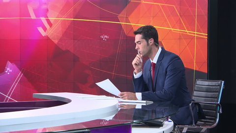 MOSCOW, RUSSIA - JULY 12, 2015: News announcer in the studio international TV channel.