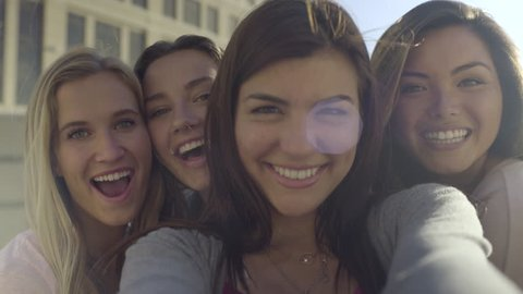Closeup Of Carefree Teen Girls Making Funny Faces And Smiling For Selfies (4K)