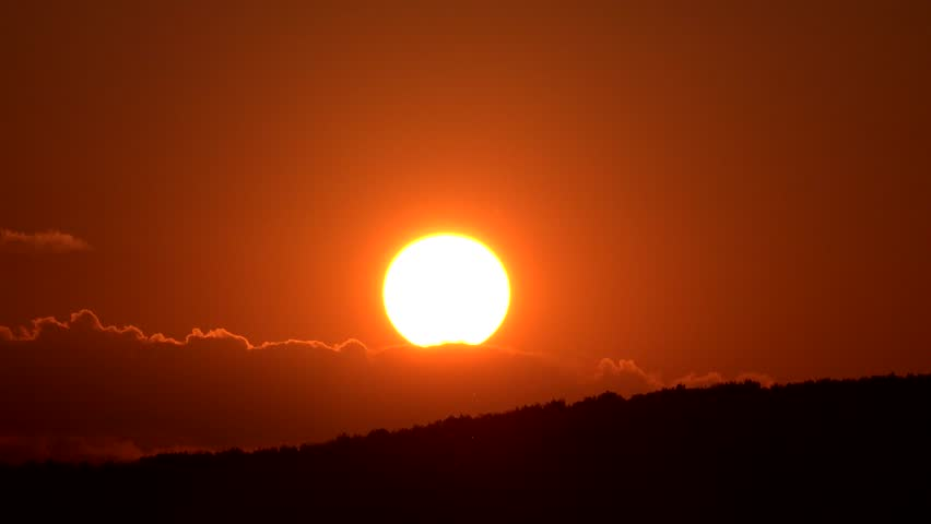 4K Timelapse of sun silhouette go down at sunset over mountain forest  #10849691