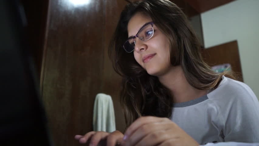 Young attractive Brazilian woman on her computer. Low angle 1080p HD.   Shutterstock HD Video #10854251