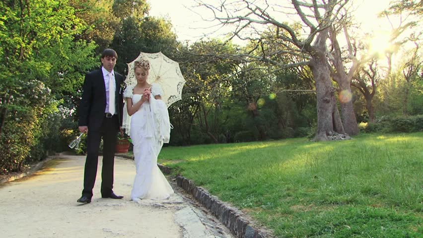 Bride and groom on a picnic in a park. Slowmotion | Shutterstock HD Video #10871471