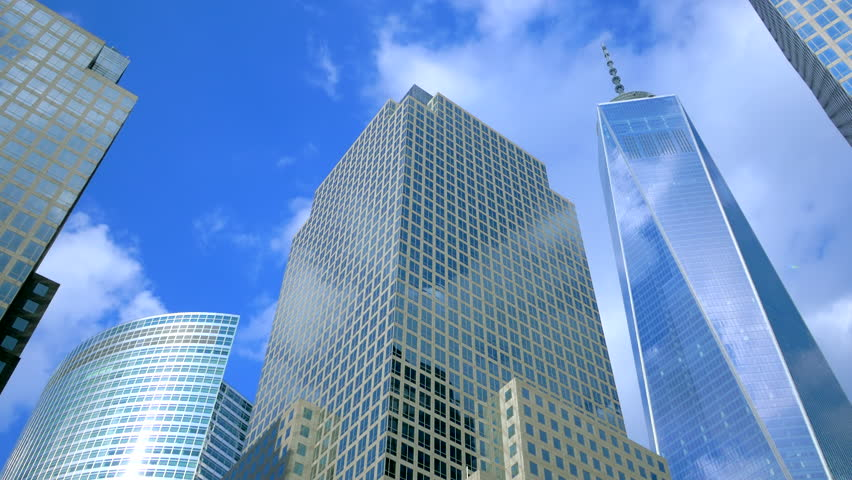 Sky and clouds reflecting over the facades of NYC World Financial Center buildings  | Shutterstock HD Video #10877561