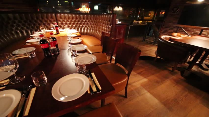 Served table for several persons with chairs around in restaurant | Shutterstock HD Video #10927871