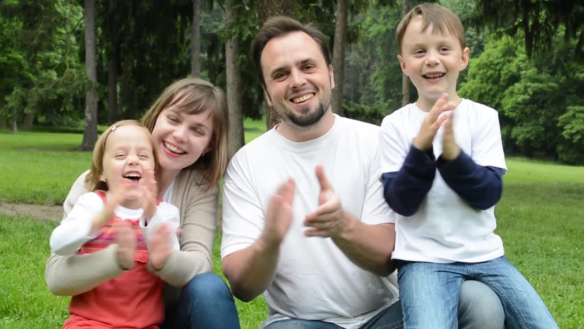 Family middle couple in love cute girl and small boy together family middle couple in love cute girl and small boy together clap ones hands in the park stock footage video 10948361 shutterstock negle Image collections
