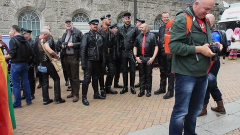Fetishism - group of men wearing leather clothes posing during gay pride - Victoria Square, Birmingham Gay Pride, England 2015