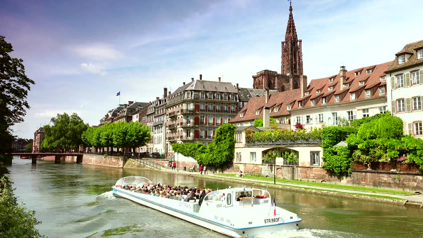 STRASBOURG, FRANCE - CIRCA May 2015: View of Strasbourg canal and Ill river  with rooftop of Cathedral in background;ultra hd 4k,