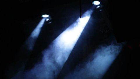 Rock concert stage with colored spotlights and smoke