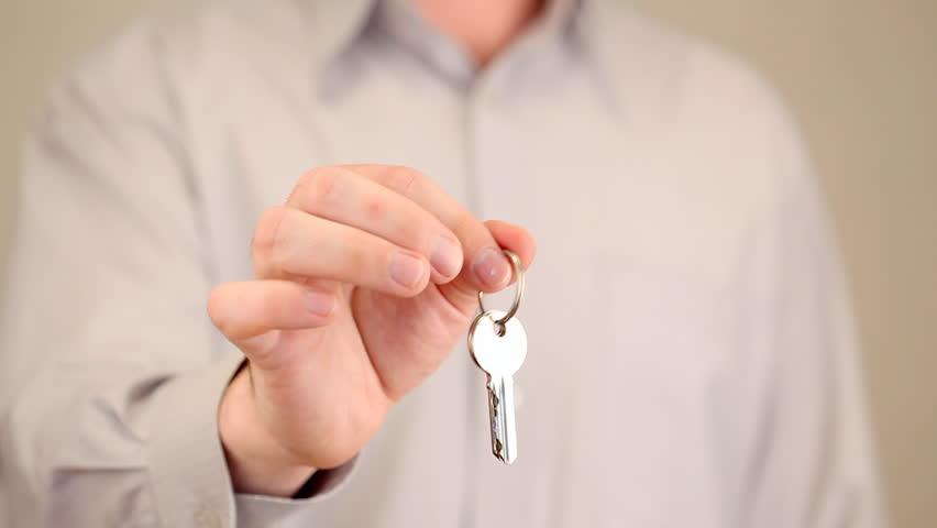 Hand holding keys | Shutterstock HD Video #1098649