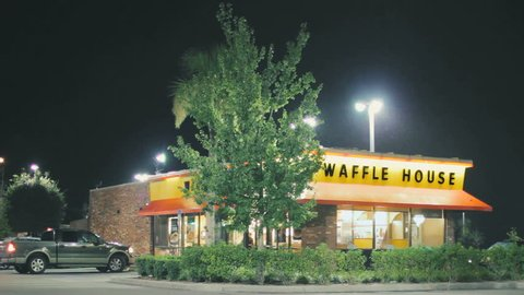 TAMPA, FL - JULY 30, 2015: Waffle House restaurant open for late night business on July 30, 2015. Waffle House, Inc., is a restaurant chain with more than 2,100 locations in 25 states in the United States.
