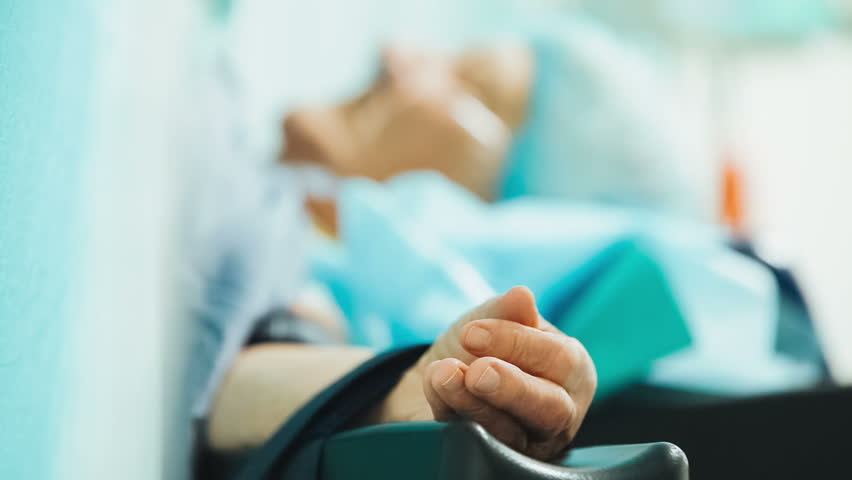 The patient is under anesthesia. The hand of patient under anesthesia during surgery.  | Shutterstock HD Video #11033354