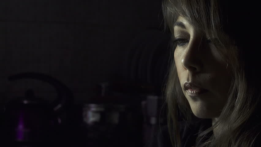 Woman smokes in the dark  | Shutterstock HD Video #11044661
