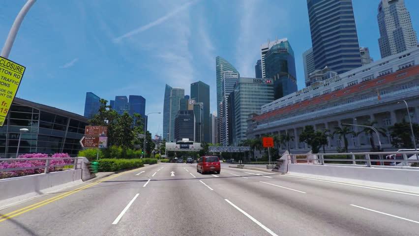 SINGAPORE - CIRCA APRIL 2015: POV, driving on freeway towards business district Raffles place, Singapore.