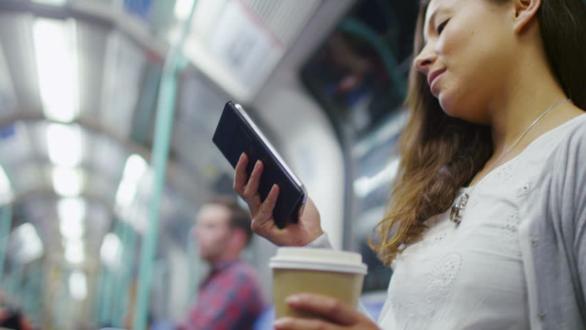 4K Attractive woman on a  train reading her phone, shot on RED EPIC | Shutterstock HD Video #11090675