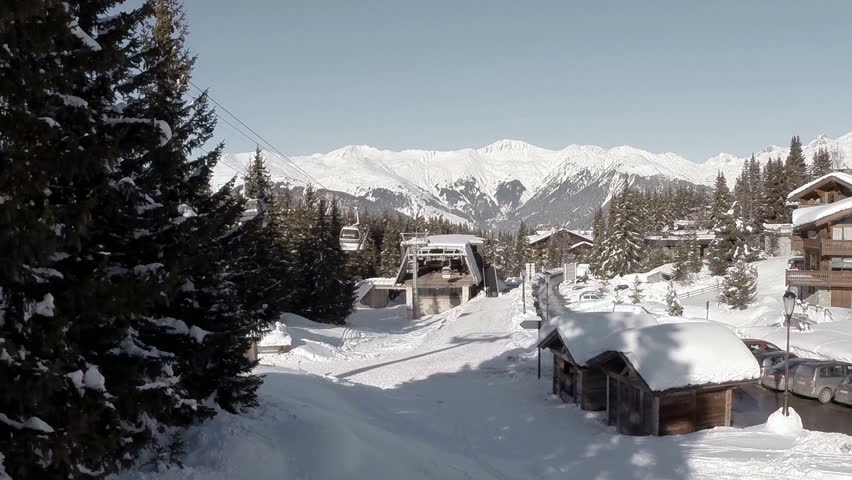 Aerial shot of people skiing in a french ski resort in the Alps