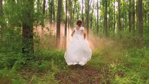 Beautiful Young Bride White Dress Running Through Forest Sun Shining Through Trees Sunset Fairy Tale Princess Beauty Vintage Concept Slow Motion