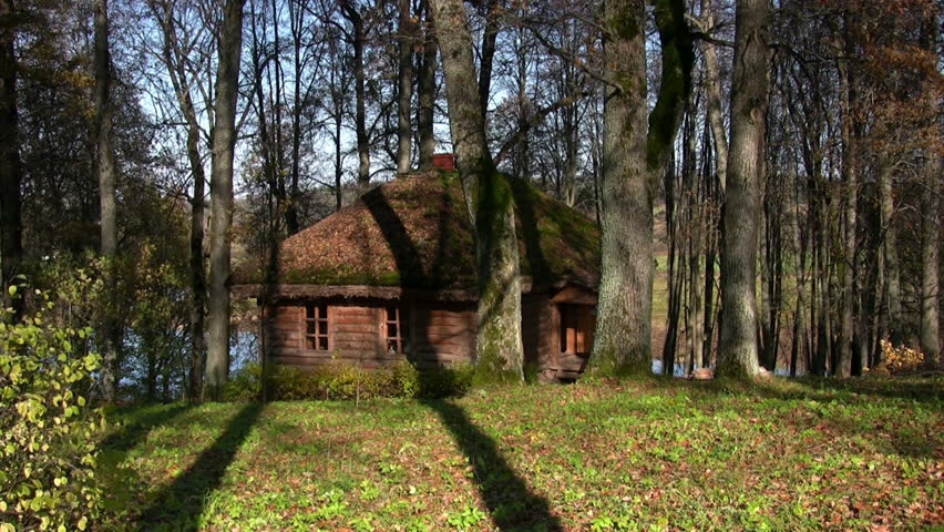 Small Log Cabin Surrounded By Withered Trees The Log