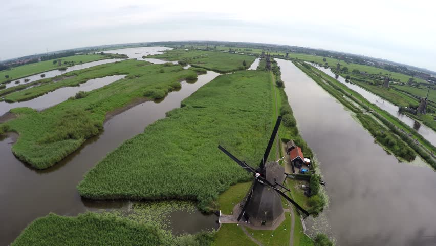 Aerial Kinderdijk Childrens Dike flight around a windmill Unesco World Heritage Unique Dutch sight and the most popular tourist attraction in Holland The Netherlands exists of 17 mills 4k from sky