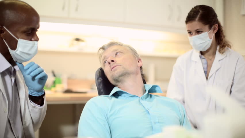Doctor Meeting Couple In Doctor S Office Stock Footage