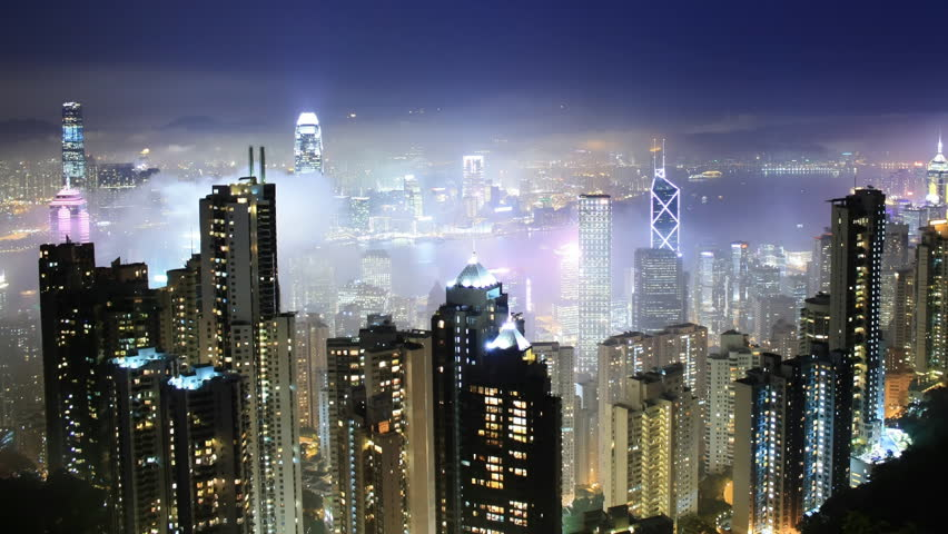 Time lapse Hong Kong skyline from famous Peak View at night. Fog comes into the city.  #1117294
