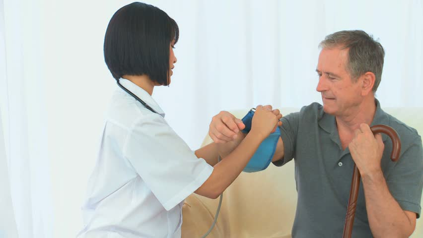 Nurse checking the blood pressure of her patient
