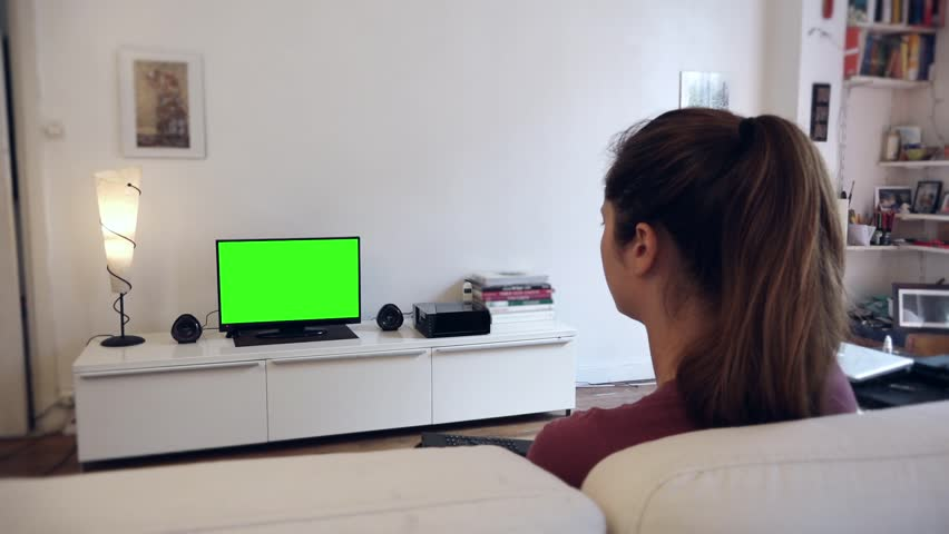 Remote Control Green Screened Tv Living Room Full Hd Switch Channels On Television With Screen Shot Behind Model S Shoulders