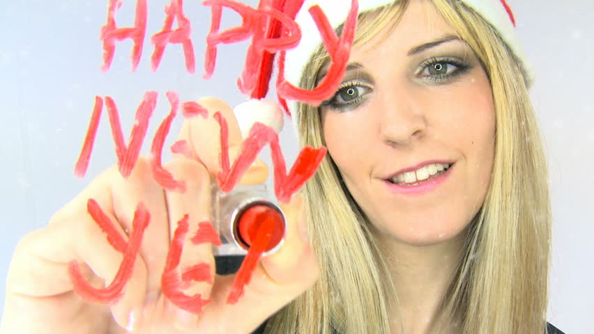 Happy New Year. Beautiful girl sending a message. | Shutterstock HD Video #1124587