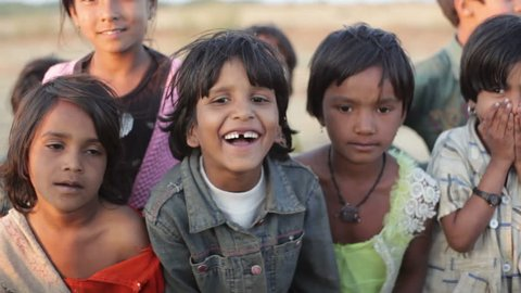 ANDHRA PRADESH, INDIA - CIRCA MAY 2013 - Happy laughing children, India, close up, shallow DOF