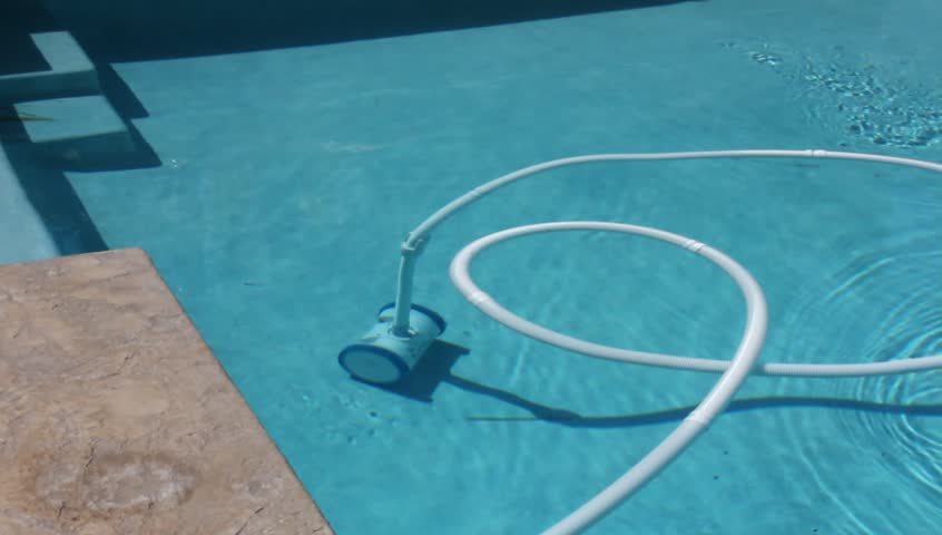 A video of a pool stock footage video 100 royalty free 1127611 shutterstock for Swimming pool cleaning machine